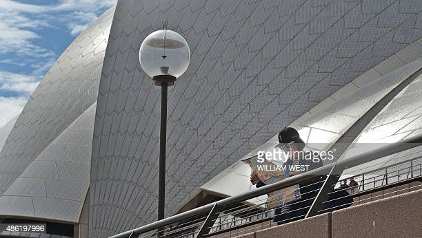 A tourist looks at her map in front of the Sydney Opera House on September 2 as data showed a boom in cashedup visitors from China and India has...