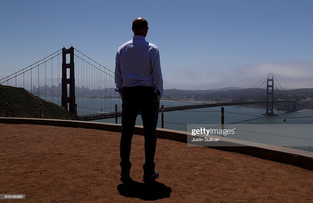 A tourist looks at the Golden Gate Bridge on June 28, 2016 in Sausalito, California. A new video that allegedly supports ISIL has emerged on the internet shows San Francisco's iconic Golden Gate Bridge as well as the office building at 555 California.