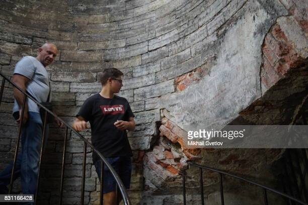 A tourist looks on the wall polluted with graffiti inside the Saint Isaac's Cathedral August 12 2017 in Central Saint Petersburg Russia Saint Isaak's...