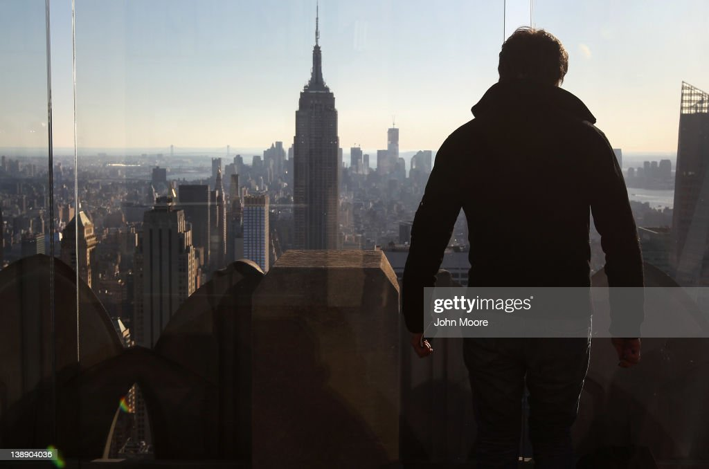 A tourist looks towards the Empire State Building from Top of the Rock Observation Deck on February 13, 2012 in New York City. The owner of the Empire State Building, Malkin Holdings, plans to raise up to $1 billion in an initial public offering on the 102-story Manhattan landmark.
