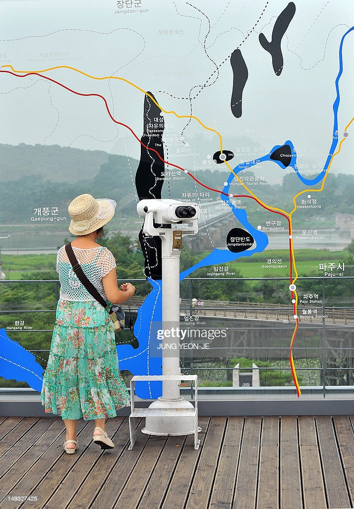A tourist looks towards the north side of the South Korean border at Imjingak peace park in Paju, near the demilitarized zone dividing the two Koreas on July 27, 2012, on the day of the 59th anniversary of signing the Korean War armistice. The armistice agreement on July 27, 1953 brought three years of active combat in the Korean War to a halt, but the two Koreas are still technically at war as no formal peace treaty was signed.