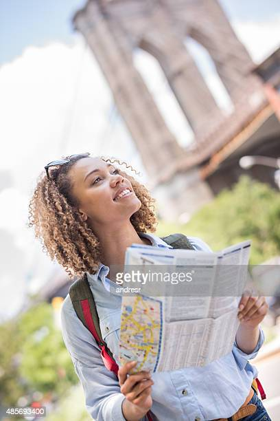 Tourist lost in New York holding a map
