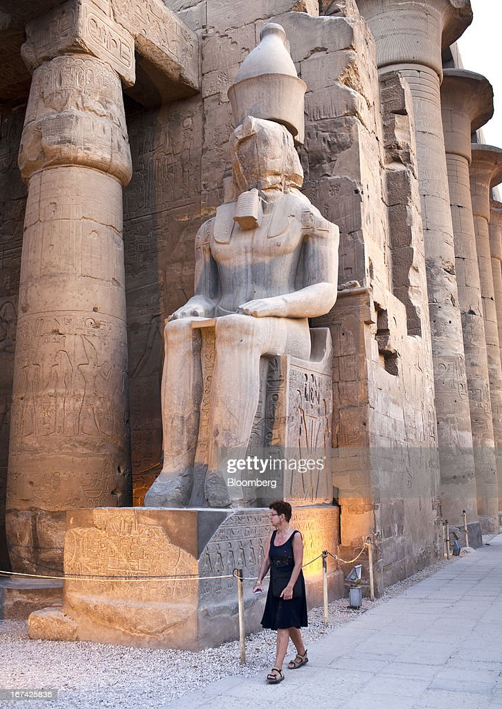 A tourist makes her way inside Luxor Temple in Luxor, Egypt, on Thursday, April 25, 2013. Egypt ranked last in terms of security and safety on the World Economic Forum's 2013 Travel and Tourism Competitiveness Index. Photographer: Shawn Baldwin/Bloomberg via Getty Images