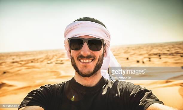 tourist man doing a selfie on the desert