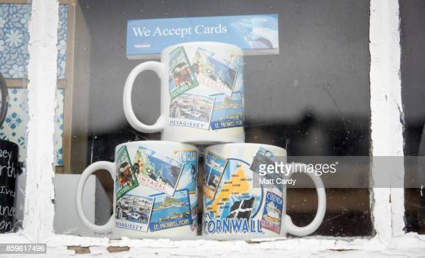 Tourist mugs are displayed for sale in a shop in the village of Mevagissey which has submitted plans to limit the number of second homes on October 9...