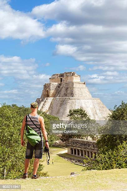 Tourist near temple in the ruins of Uxmal, Mexico