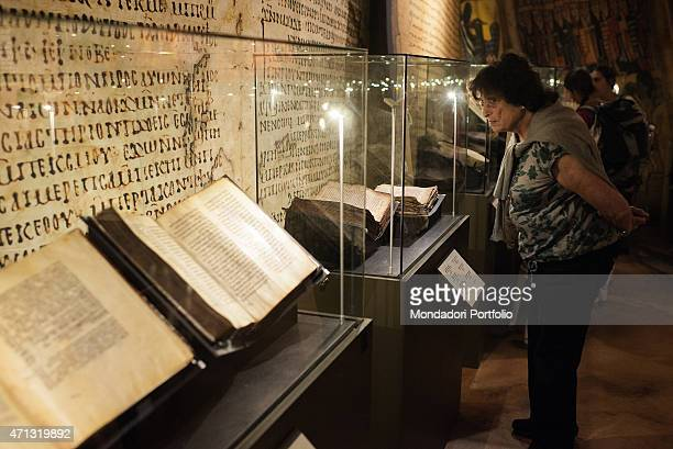 A tourist observes a glass case with an ancient book in the Bible Lands Museum during the exhibition dedicated to the Bible The Book of the books...