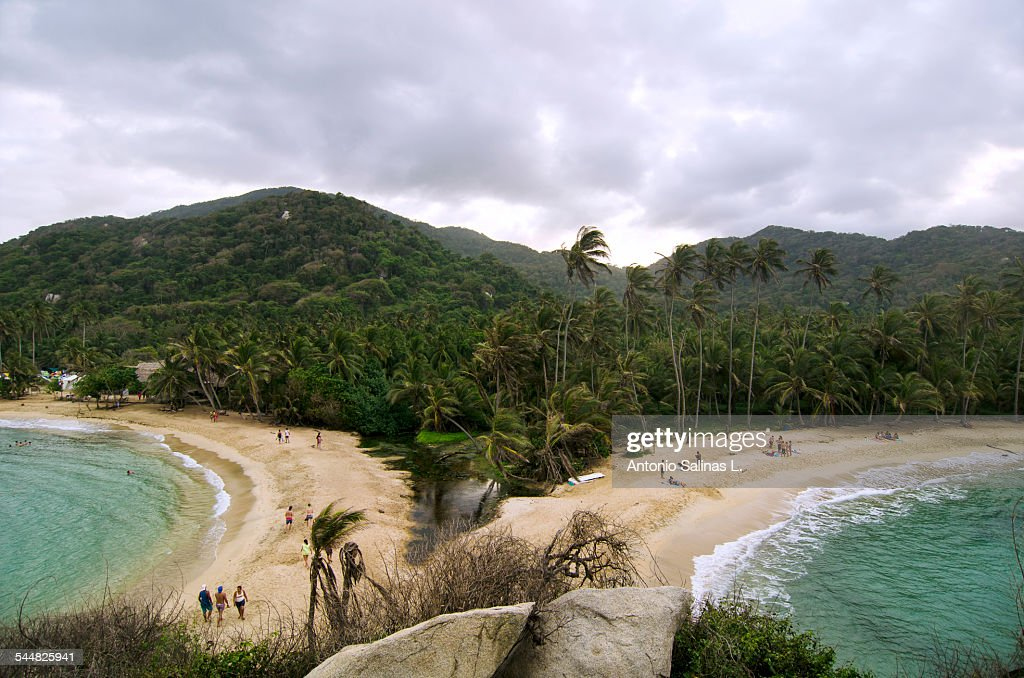 Tourist on a caribbean beach with palm trees