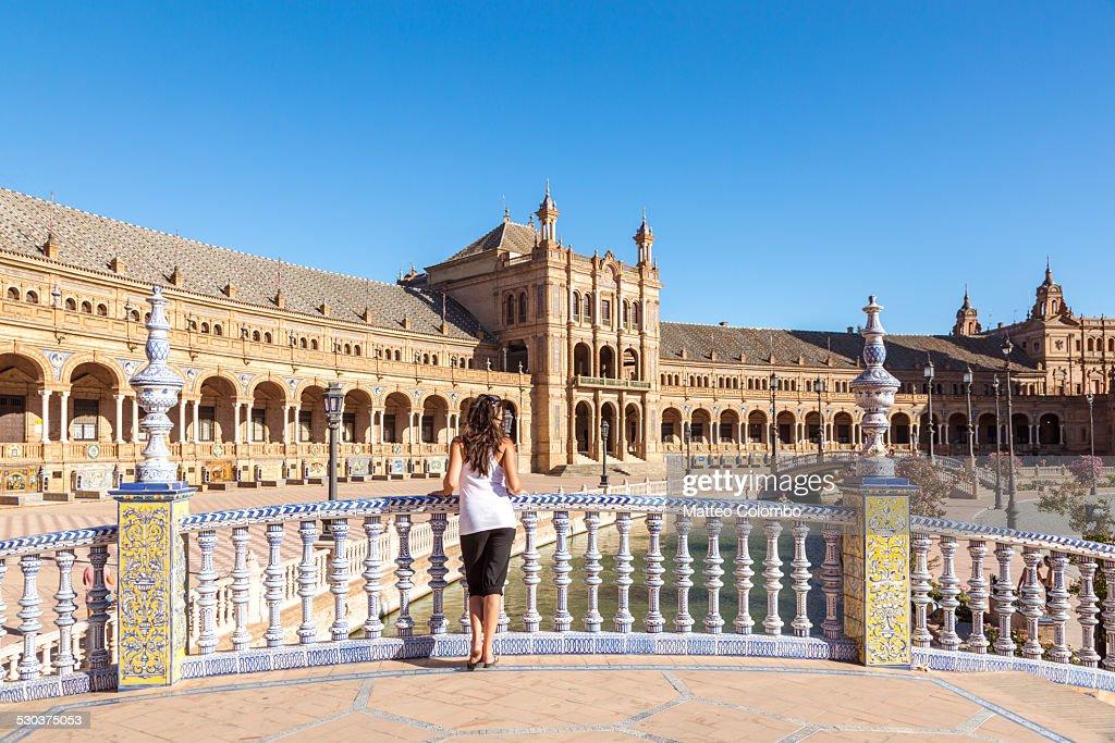 Tourist on bridge in Plaza de Espana, Seville
