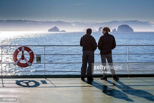Tourist on deck, Scoresbysund, Greenland,