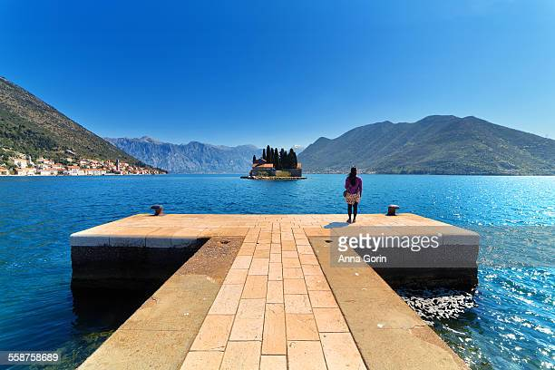 Tourist on island off coast of Perast, Montenegro