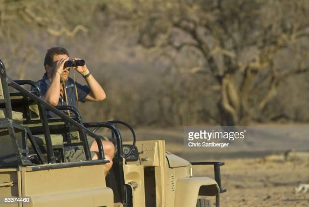 tourist on safari watching wildlife