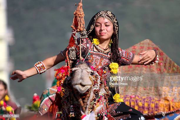 A tourist performs dance during the 'World Tourism Day' celebration at Pushkar
