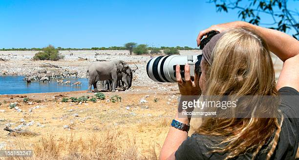 Tourist photographer on safari in Africa