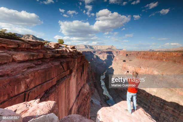 Tourist photographing the Grand Canyon, USA