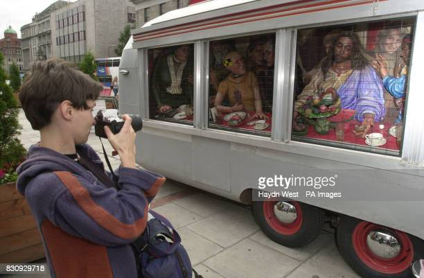 A tourist photographs a work of art titled 'The Diner' by Texan artist Greg Metz on show in the middle of O'Connell Street in Dublin City centre the...