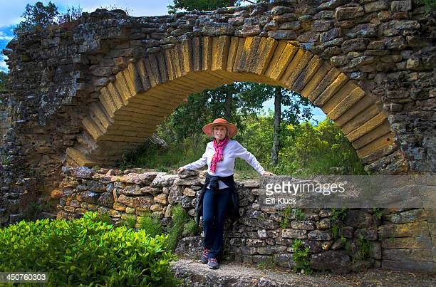 Tourist poses at Roman Aqueduct