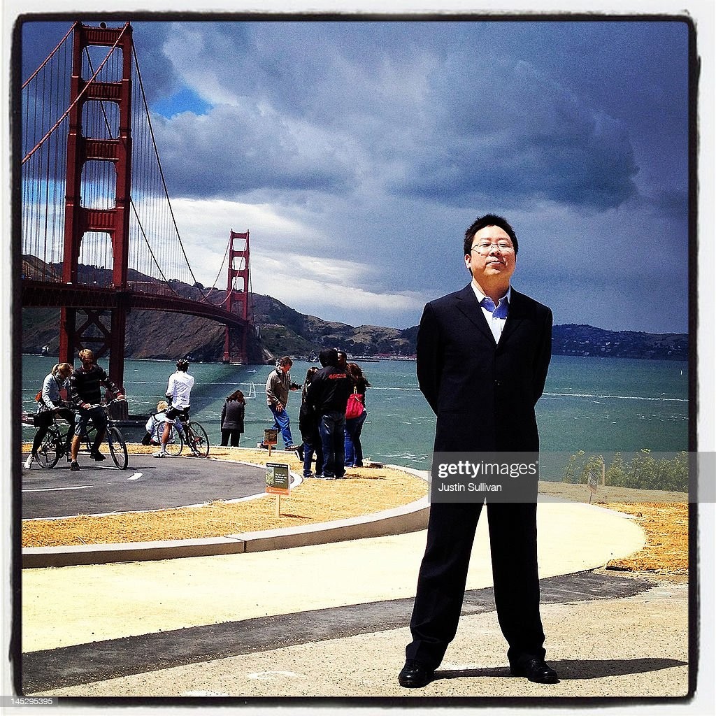 A tourist poses for a photo in front of the Golden Gate Bridge on May 25, 2012 in San Francisco, California. The Golden Gate Bridge, Highway and Transportation District is preparing for the 75th anniversary of the iconic Golden Gate Bridge that will be marked with a festival on May 26 - 27 that will feature music, displays of bridge artifacts and art exhibits. The 1.7 mile steel suspension bridge, one of the modern Wonders of the World, opened to traffic on May 27, 1937.