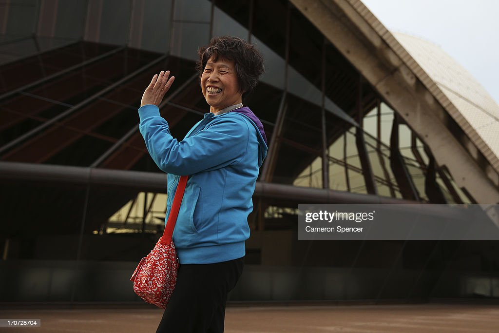 A tourist poses for a photograph at the Sydney Opera House on June 12, 2013 in Sydney, Australia. The New South Wales government is expected to commit AUD $14 million in it's 2014-15 budget to a ten year plan that will see the Sydney Opera House refurbished and it's facilities upgraded. The world-heritage listed landmark will celebrate it's 40th anniversary this October.