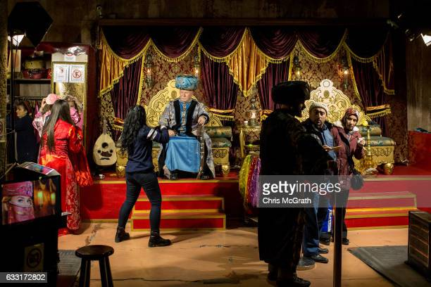 A tourist poses for a photograph in an Ottoman costume inside the famous Basilica Cistern on January 31 2017 in Istanbul Turkey According to a...