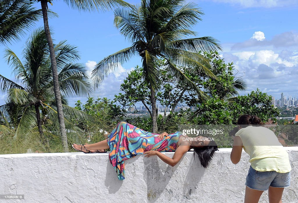 A tourist poses for a photograph in Olinda, state of Pernambuco on June 16, 2013. Olinda is located on the country's northeastern Atlantic Ocean coast, just north of Recife and it is the second oldest Brazilian city.