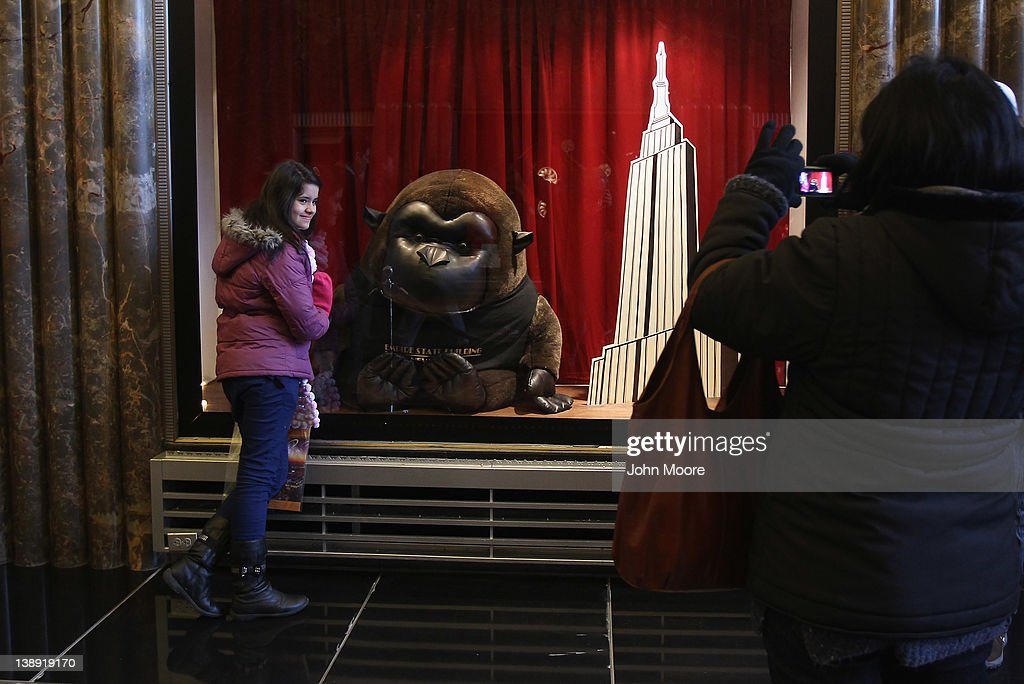 A tourist poses for photos inside the lobby of the Empire State Building on February 13, 2012 in New York City. The owner of the Empire State Building, Malkin Holdings, plans to raise up to $1 billion in an initial public offering on the 102 story Manhattan landmark.