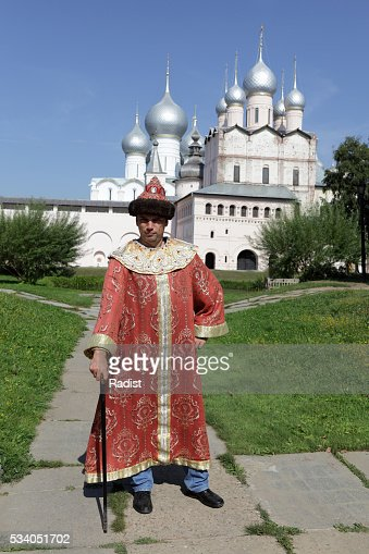 Tourist poses in historical clothes : Stock Photo