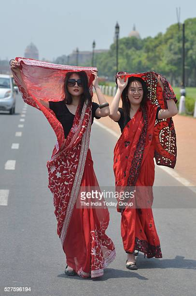 Tourist protect themselves during a hot weather in Delhi/NCR experienced yet another scorching day in New Delhi