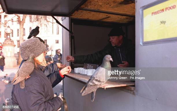 A tourist queues up to buy bird seed from Michael Mangion who is helping out on Rayner's bird seed stall in Trafalgar Square central London The last...