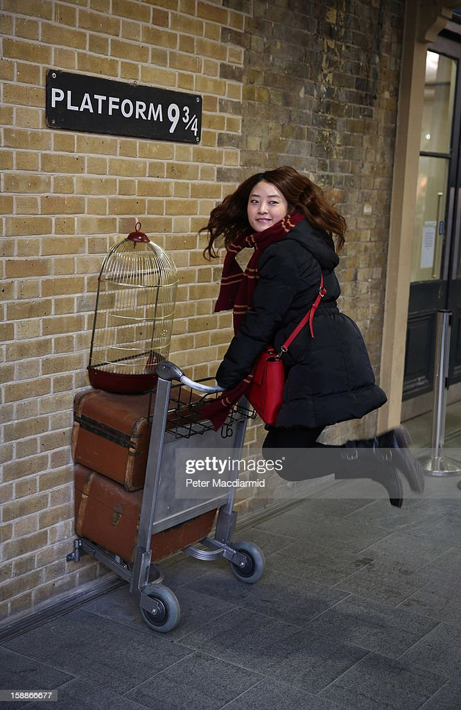 A tourist re-enacts a scene from Harry Potter at Kings Cross station on January 2, 2013 in London, England. Rail fares have today risen by an average of 4.2% in England, Scotland and Wales, the tenth year in a row that fares have increased above inflation.