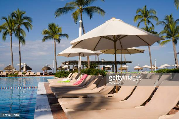 Tourist Resort Hotel Swimming Pool and Beach Chairs in Mexico