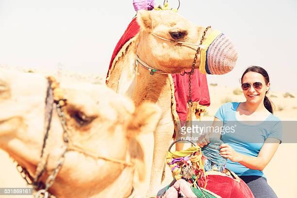 tourist riding a camel