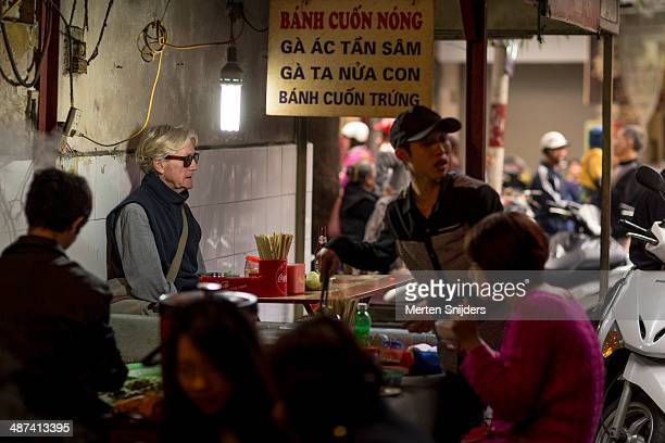 Tourist seated at street food stall