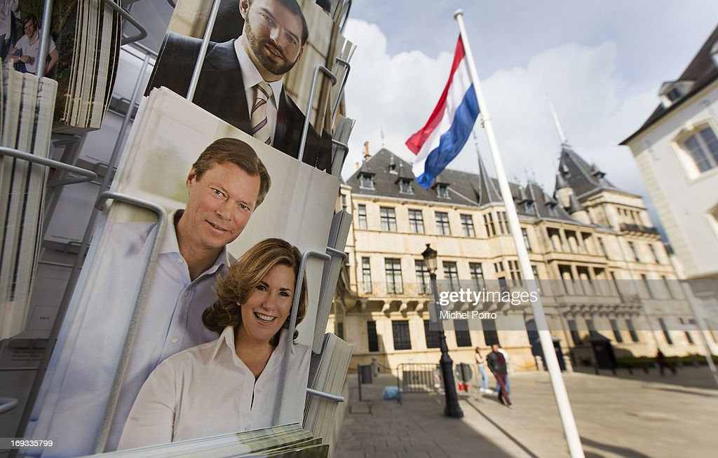 A tourist shop next to the Palace of the Grand Dukes sells postcards showing Grand Duke Henri, Grand Duchess Maria Teresa (below) and Prince Guillaume (above) while the Dutch flag is hung outside as Luxembourg prepares for the visit of King Willem-Alexander and Queen Maxima of The Netherlands on May 23, 2013 in Luxembourg, Luxembourg.