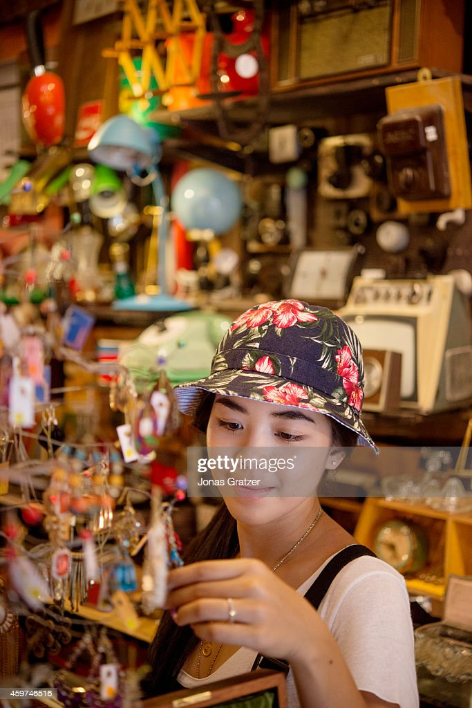 A tourist shopping in a knickknack store in the city of Hong Kong