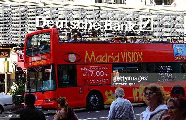 Tourist sightseeing bus passing the German bank Deutsche Bank at the famous boulevard Gran Via in Madrid on May 24 2010 in Madrid Spain Madrid is a...