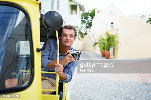 Tourist sightseeing from tuk tuk : Stock Photo