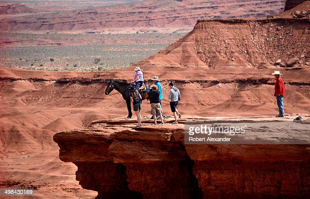 A tourist sits on a horse and poses for photographs at John Ford's Point in Monument Valley Navajo Tribal Park in southeastern Utah Ford directed...