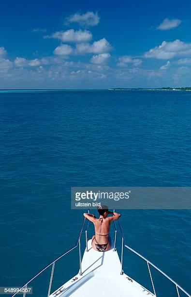 Tourist sitting on Bow Maldives Indian Ocean Medhufushi Meemu Atoll