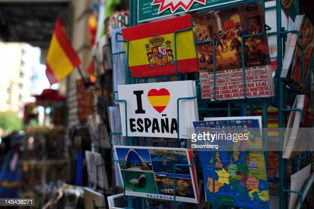 Tourist souvenir postcards including one reading 'I Love Spain' sit on a rack in Valencia Spain on Tuesday May 29 2012 The collapse of regional...