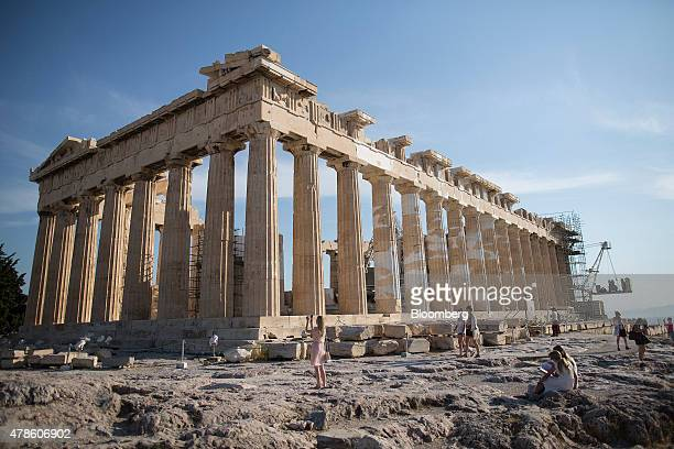 A tourist stops to take a photograph during a visit to the Parthenon temple on Acropolis Hill in Athens Greece on Wednesday June 24 2015 Greek Prime...