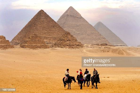 CONTENT] Tourist take a horse ride around the pyramids The Great Pyramid of Giza is the oldest and largest of the three pyramids in the Giza...