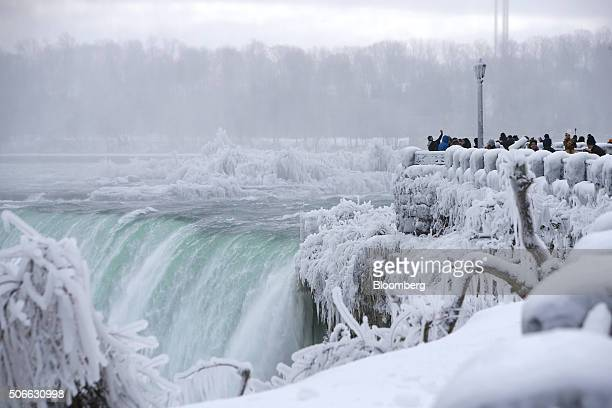 Tourist take photographs at the Horseshoe Falls in Niagara Falls Ontario Canada on Jan 23 2016 A 34 percent plunge in the Canadian dollar since 2011...