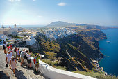 Tourist take pictures of the Aegon sea in the town of Fira on June 11 2015 in Santorini Greece Santorini is an island in the southern Argon Sea about...