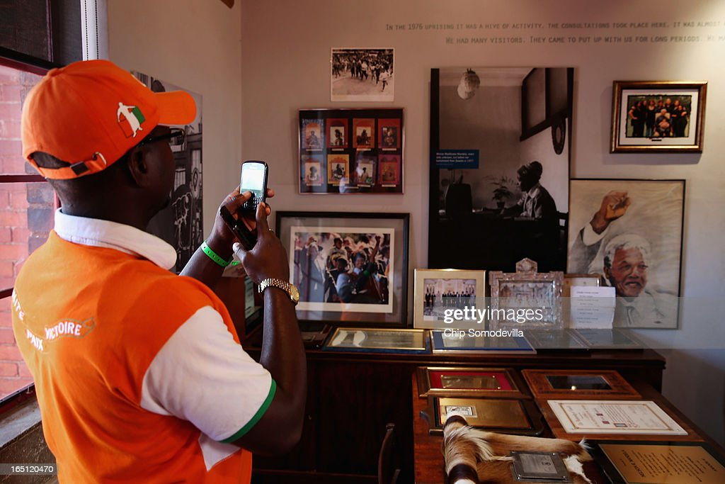 A tourist takes a photograph inside the Mandela House and Museum on historic Vilakazi Street in Soweto March 31, 2013 in Johannesburg, South Africa. From 1946 to 1990 this was the home of former South African President Nelson Mandela, 94, who is in the hospital for the third time since December with lung problems. Referring to Mandela by clan name, Madiba, President Jacob Zuma said, 'We appeal to the people of South Africa and the world to pray for our beloved Madiba and his family and to keep them in their thoughts.' Mandela's lungs were damaged when he contracted tuberculosis during his 27 years in the infamous Robben Island prison. Mandela became the nation's first democratically elected president in 1994 following the end of apartheid.