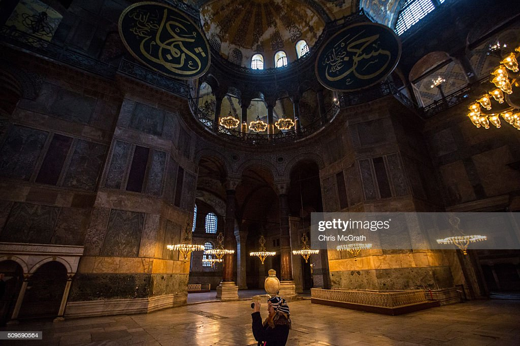A tourist takes a photograph of the interior of the Hagia Sophia Museum on February 11, 2016 in Istanbul, Turkey. The Hagia Sophia (Ayasofya) Museum is one of the most visited tourist attractions in Turkey, with more than 3 million visitors per year. Constructed in 537 the museum originally served as an Orthodox Cathedral, later a Roman Catholic church and was converted into a mosque when Constantinople was conquered by the Ottoman Turks in 1453. In 1935 it was opened as a museum by the Republic of Turkey. The museum is currently undergoing restoration on various parts of the interior.