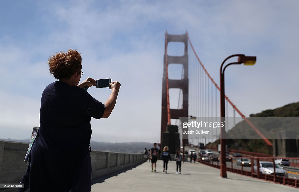 A tourist takes a picture of the Golden Gate Bridge on June 28, 2016 in Sausalito, California. A new video that allegedly supports ISIL has emerged on the internet shows San Francisco's iconic Golden Gate Bridge as well as the office building at 555 California.