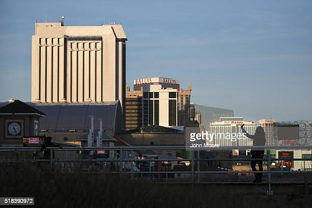 A tourist takes a 'selfie' along the casinolined boardwalk on March 30 2016 in Atlantic City New Jersey The Atlantic City municipality is due to run...