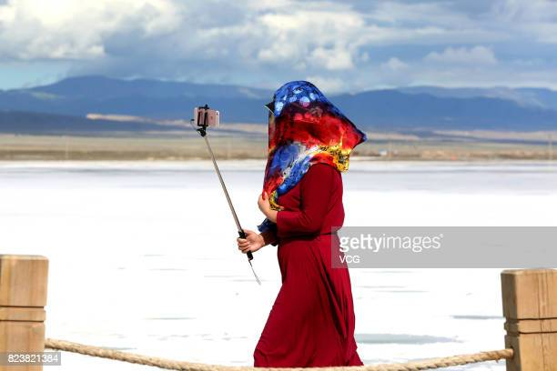 A tourist takes a selfie around Chaka Salt Lake at Chaka Town on July 27 2017 in Haixi Mongolian and Tibetan autonomous Prefecture Qinghai Province...