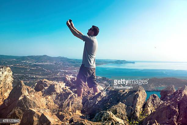 Tourist takes a selfie with camera phone at vista point